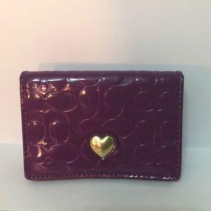 Purple coach coin purse/ card holder